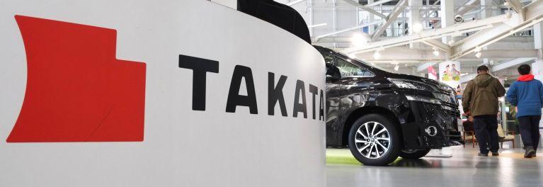 A photo of a Takata logo/airbag.