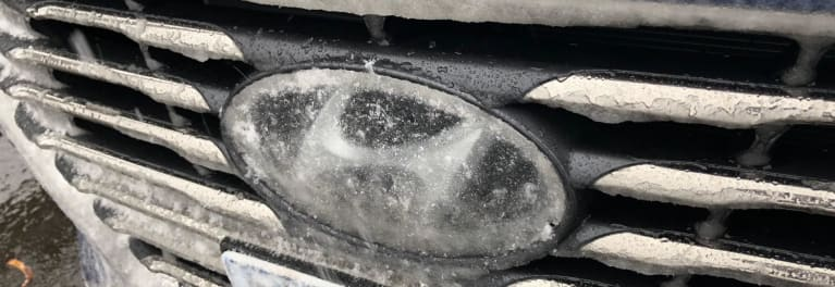 Hyundai Sonata grille covered in ice.