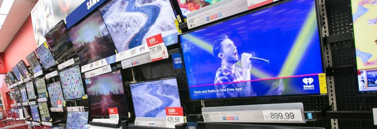 TVs on display in an electronics store.