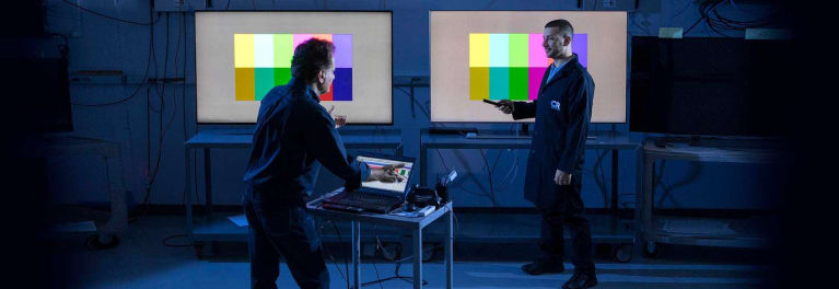Photos of Consumer Reports testers in the TV lab with Samsung QLED and Sony X930E 4K TVs..