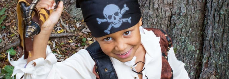 A young boy in a pirate costume.