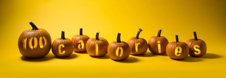 Pumpkins spelling out 100 calories.