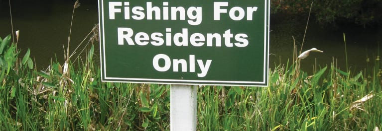 "A sign that says ""fishing for residents only."""
