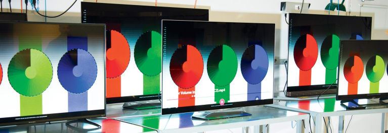 4K HDR TVs displaying a test pattern that shows whether a TV can maintain color intensity as brightness changes.