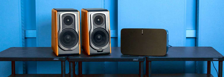 A pair of Edifier S1000DB speakers on a table next to a Sonos Play:5 speaker.