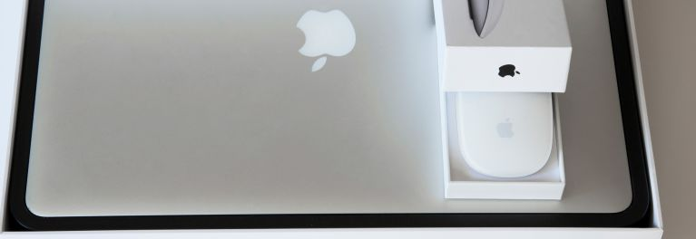 An Apple laptop and mouse for an article on refurbished electronics