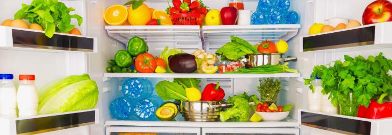 Food inside an open French-door refrigerator.