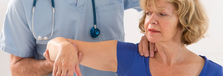 Osteoporosis medication to reduce the risk of a fracture. Image: Woman's arm being examined by doctor.
