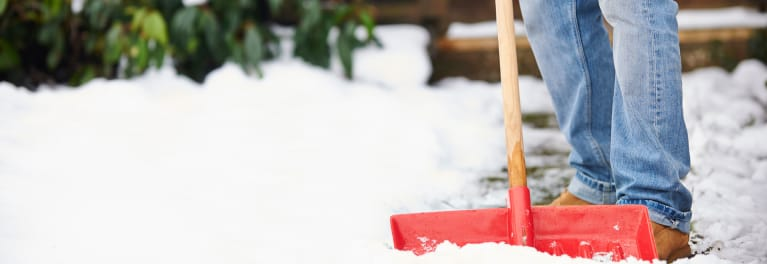 Shoveling a driveway with a typical snow shovel.