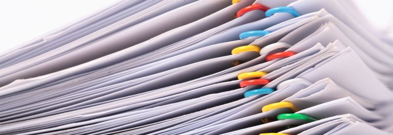 piles of paper needed for tax preparer