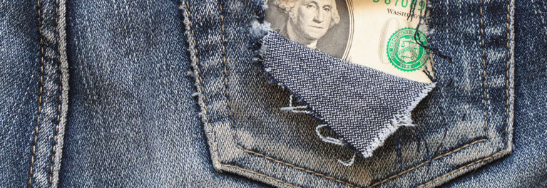 A dollar showing through the back pocket of a pair of old jeans.