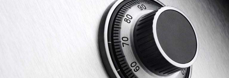 A close-up image of a safe's combination dial lock.