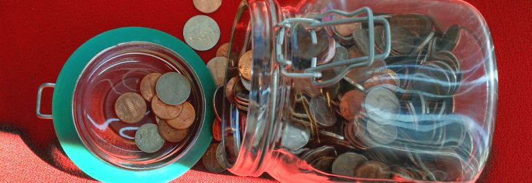 A coin jar. Now you can invest the electronic version of spare change.