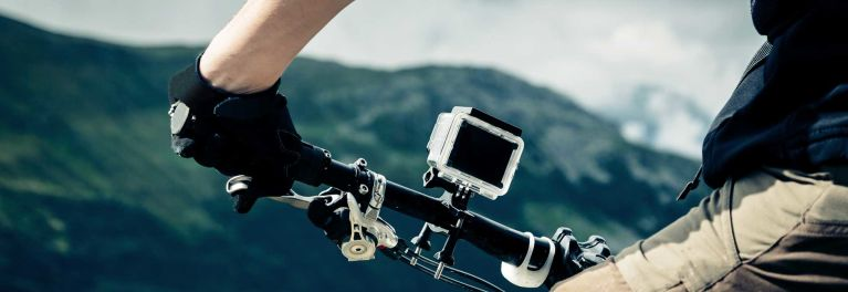 an action cam mounted on a bike for a story about the best action cams for $300 or less