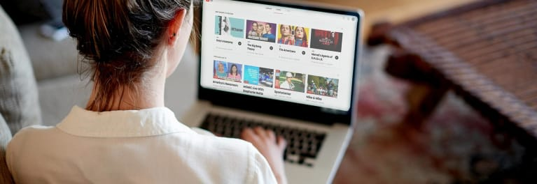 Photo of person watching YouTube TV on a laptop computer.