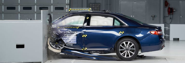 Car Safety Ratings - A photo of a 2017 Lincoln Continental during an IIHS crash test.