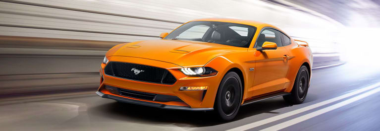 A Photo Of 2018 Ford Mustang Gt In Bright Orange An Atypical Automotive Paint