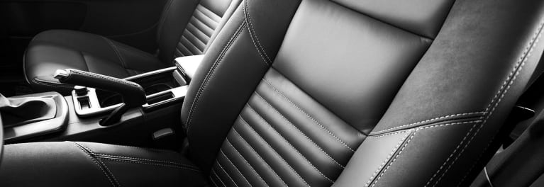 A photo a leather car interior, a feature that may not may not be found in most comfortable cars.