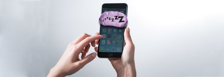 Zzzzzs over a smartphone to illustrate an iPhone slowing down