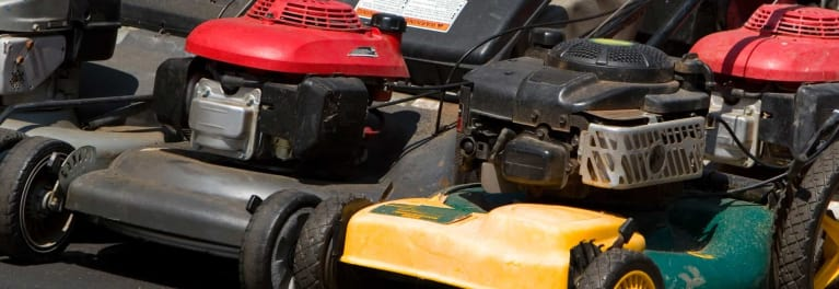 Old mowers at a lawn mower exchange.