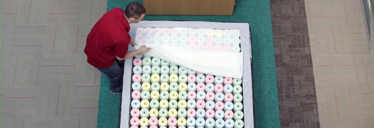 A Reverie mattress being tested by Consumer Reports