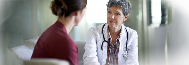 A surgeon and patient discussing the possibility of mastectomy.