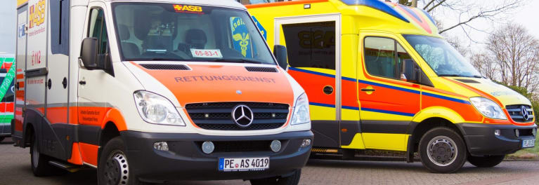 European ambulances remind U.S. travelers overseas of the need for international travel health insurance.