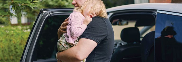 A father and daughter use the Safest Car Seat