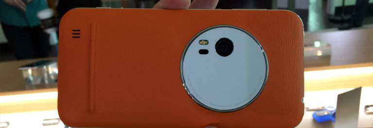 Close-up of the rear side of the Asus ZenFone Zoom smartphone showing with the orange leather trim