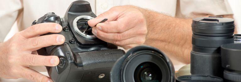 This is a repairman repairing a digital camera