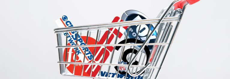 Photo of a shopping cart with logos of different shows in the Verizon FiOS TV packages.