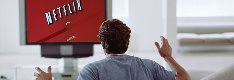 Photo of a person watching Netflix buffering on his TV.