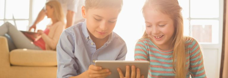Kids playing with tablets