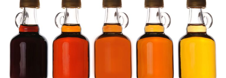 Bottles of maple syrup.