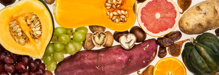 Fall foods such as butternut squash, acorn squash, sweet potaotes, and grapes.