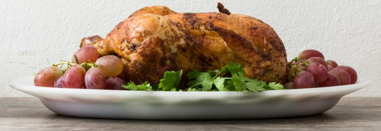 This is a photo of a beautiful Thanksgiving meal. Putting an organic turkey in your shopping cart can help prevent antibiotic-resistant bacteria.