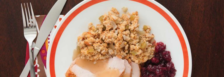Turkey, cranberry sauce, and stuffing on a plate.