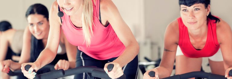 Women on exercise bikes