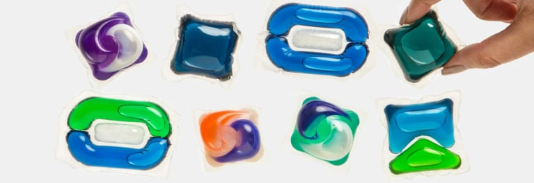 An array of laundry detergent pods and packets.