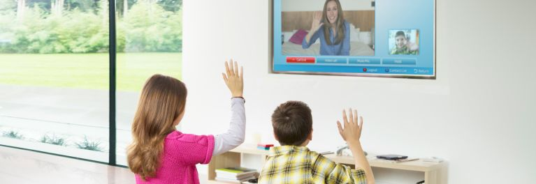 Photo of people watching a smart TV that is capable of TV snooping.
