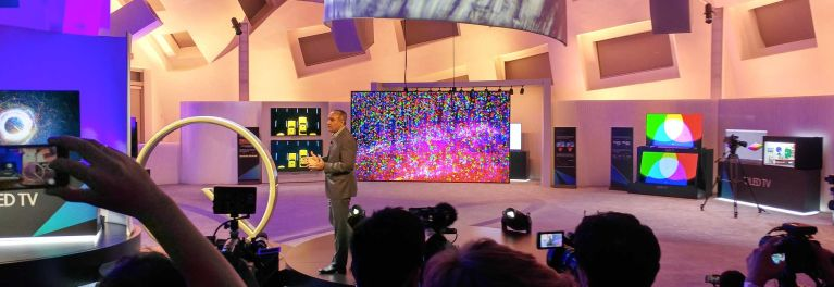 Photo of Samsung senior VP Dave Das showing new QLED quantum-dot TVs at CES 2017.