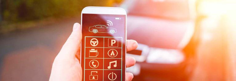 A mobile phone app open in front of a car.