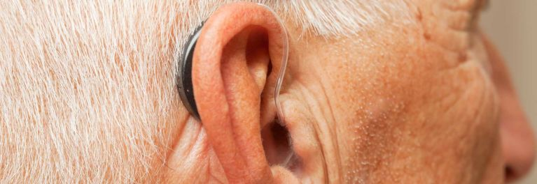 A man wearing a hearing aid.