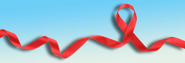 A red ribbon for HIV awareness. Every person should receive an HIV test.