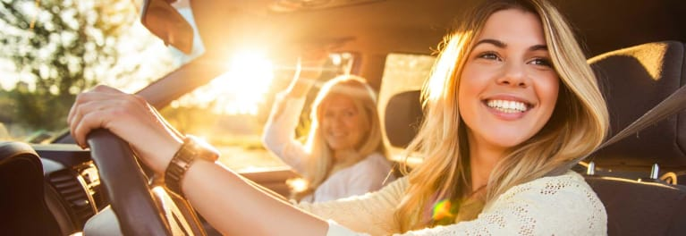 Two teen-age girls in a car.
