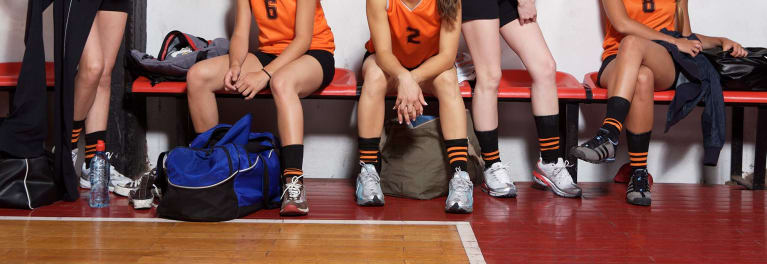 Young athletes on a bench in a gym