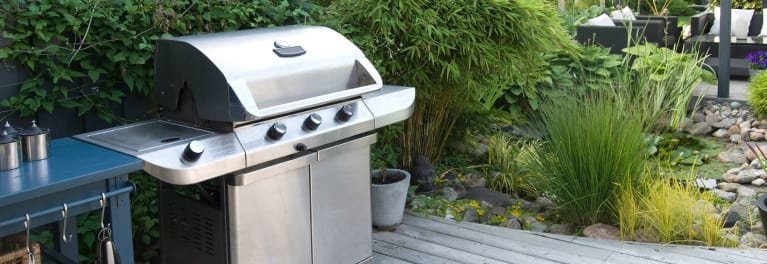 Learn how to clean a stainless steel grill on a deck