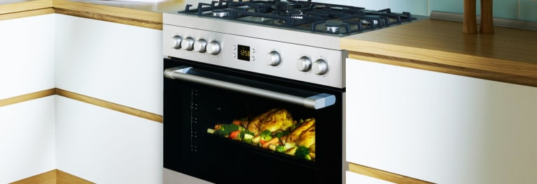 A photo of a range with a large oven.