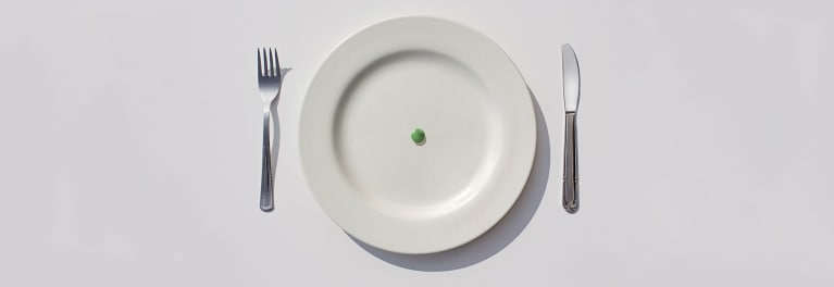 A pea on a dinner plate. Intermittent fasting for weight loss has pros and cons.