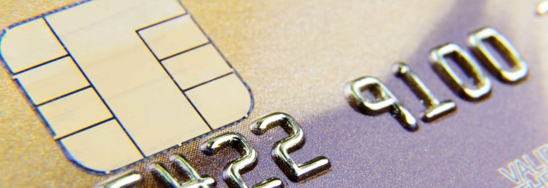 Closeup of a credit card with a chip. A lawsuit calls for chip-and-PIN technology.